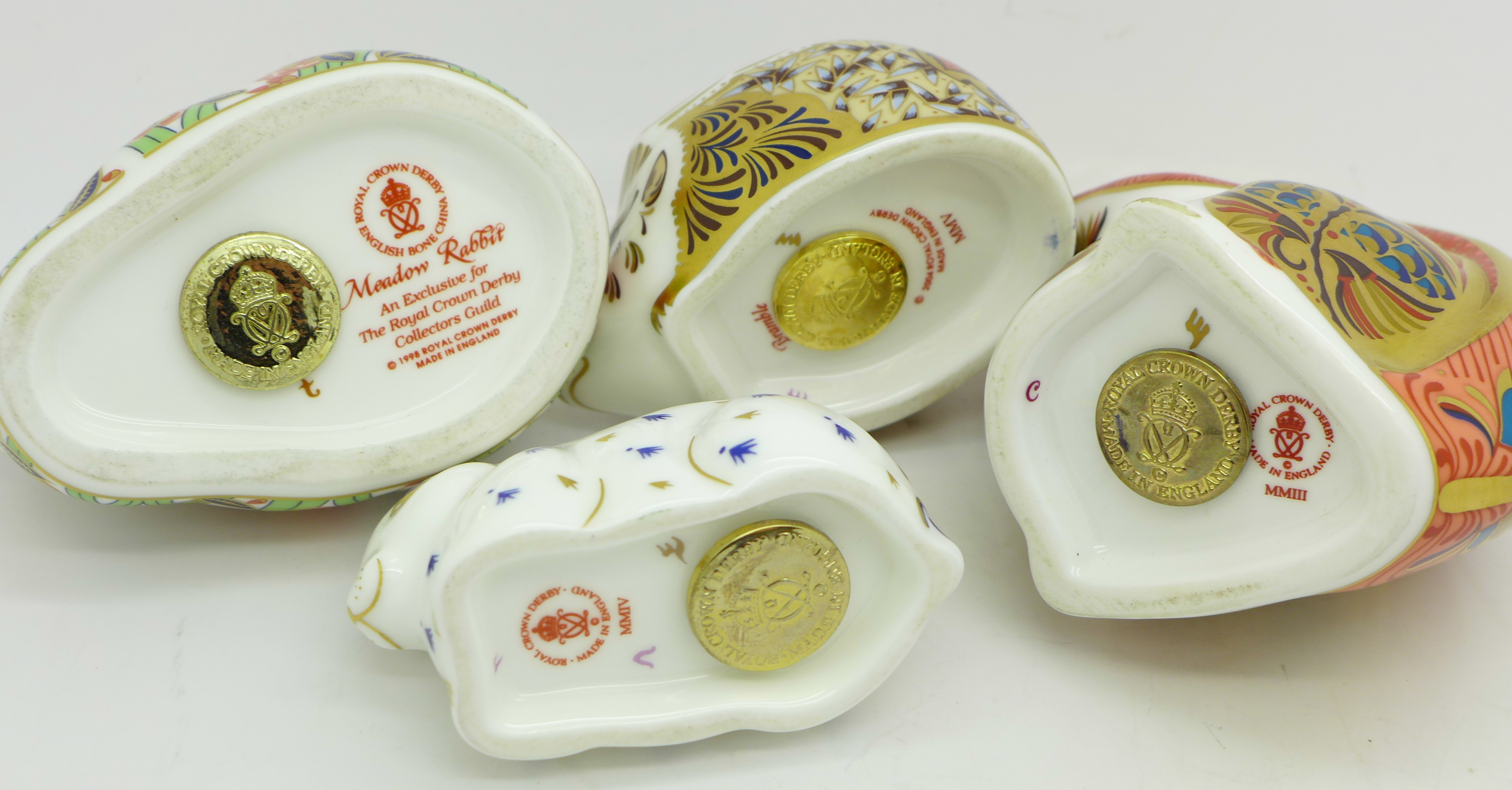 Lot 613 - Four Royal Crown Derby paperweights,