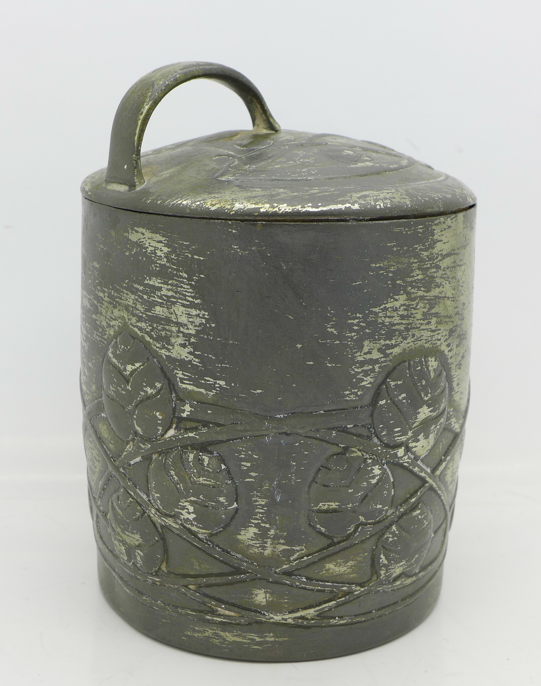 Lot 634 - A Tudric pewter lidded jar, designed by Archibald Knox, 0700, height with handle 13.