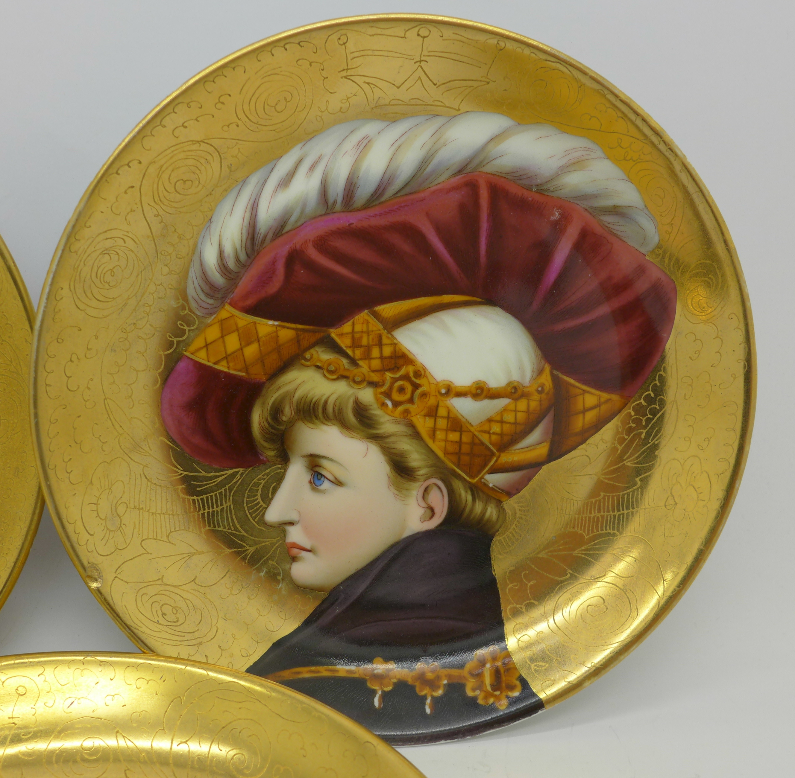 Lot 614 - Three hand painted porcelain plates, each with European beauties, one with chip to outer rim,
