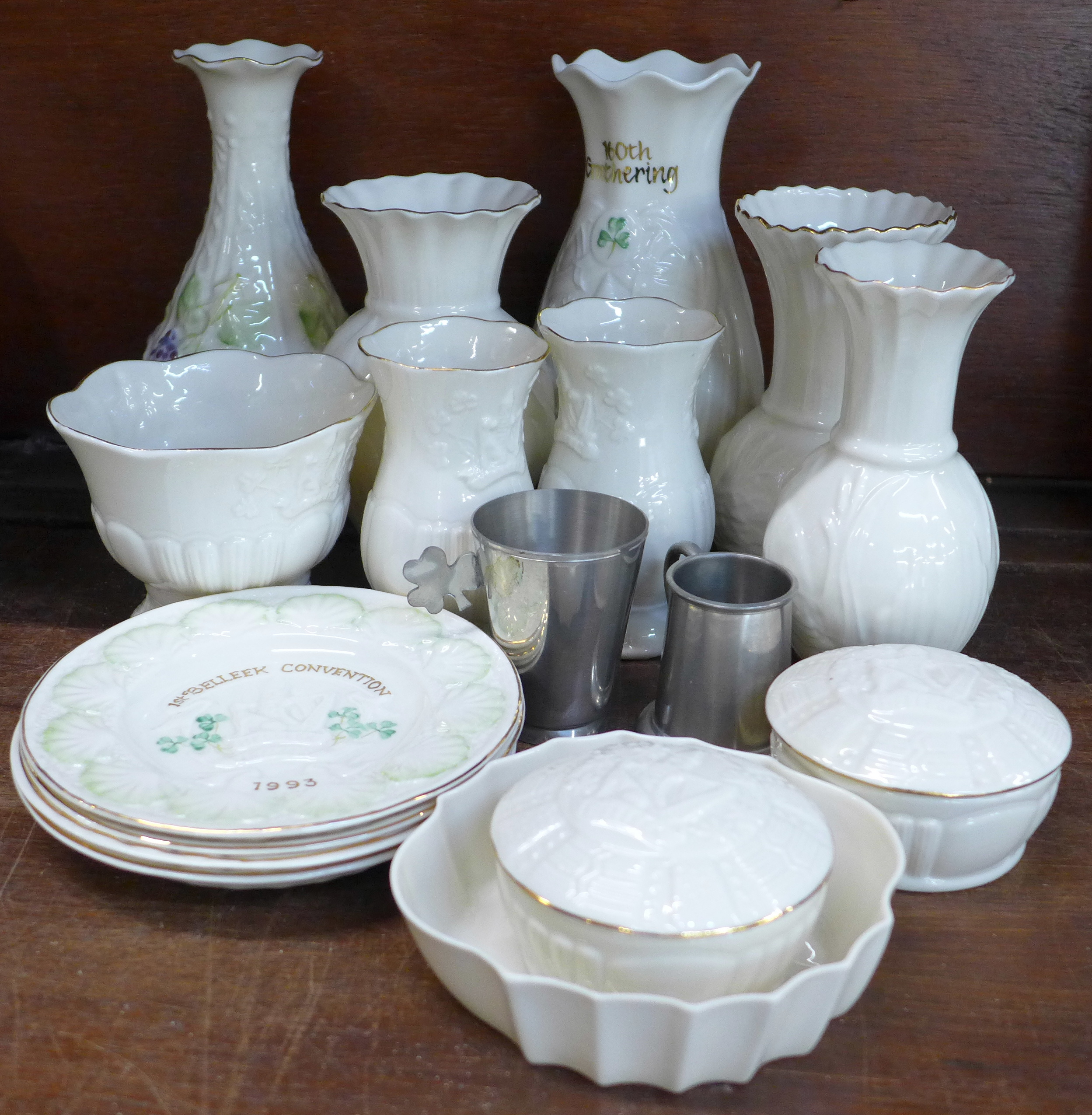 Lot 647 - Fifteen Belleek vases and plates and two Irish pewter cups,