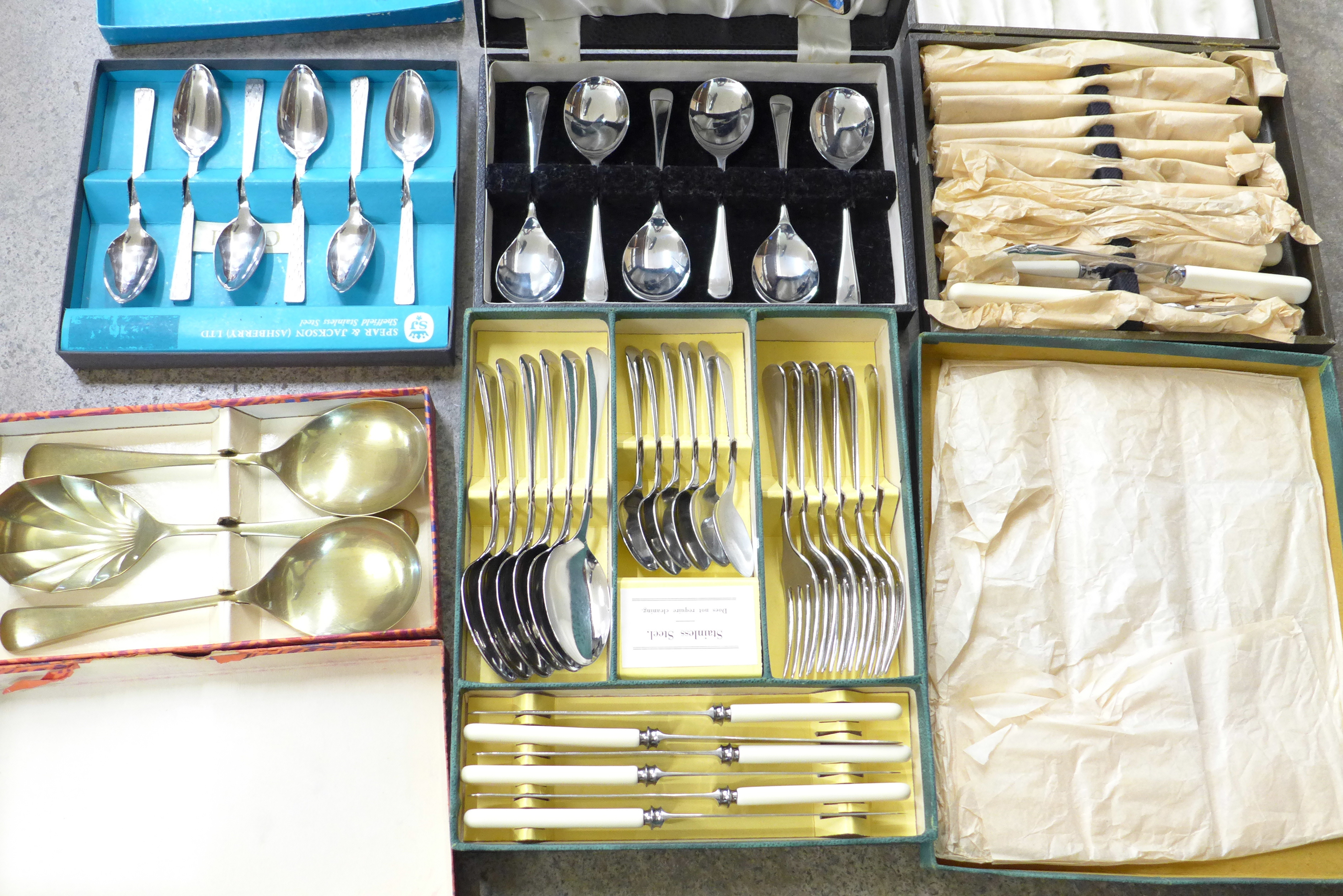 Lot 693 - Five boxes of flatware; fish knives and forks, fruit servers,