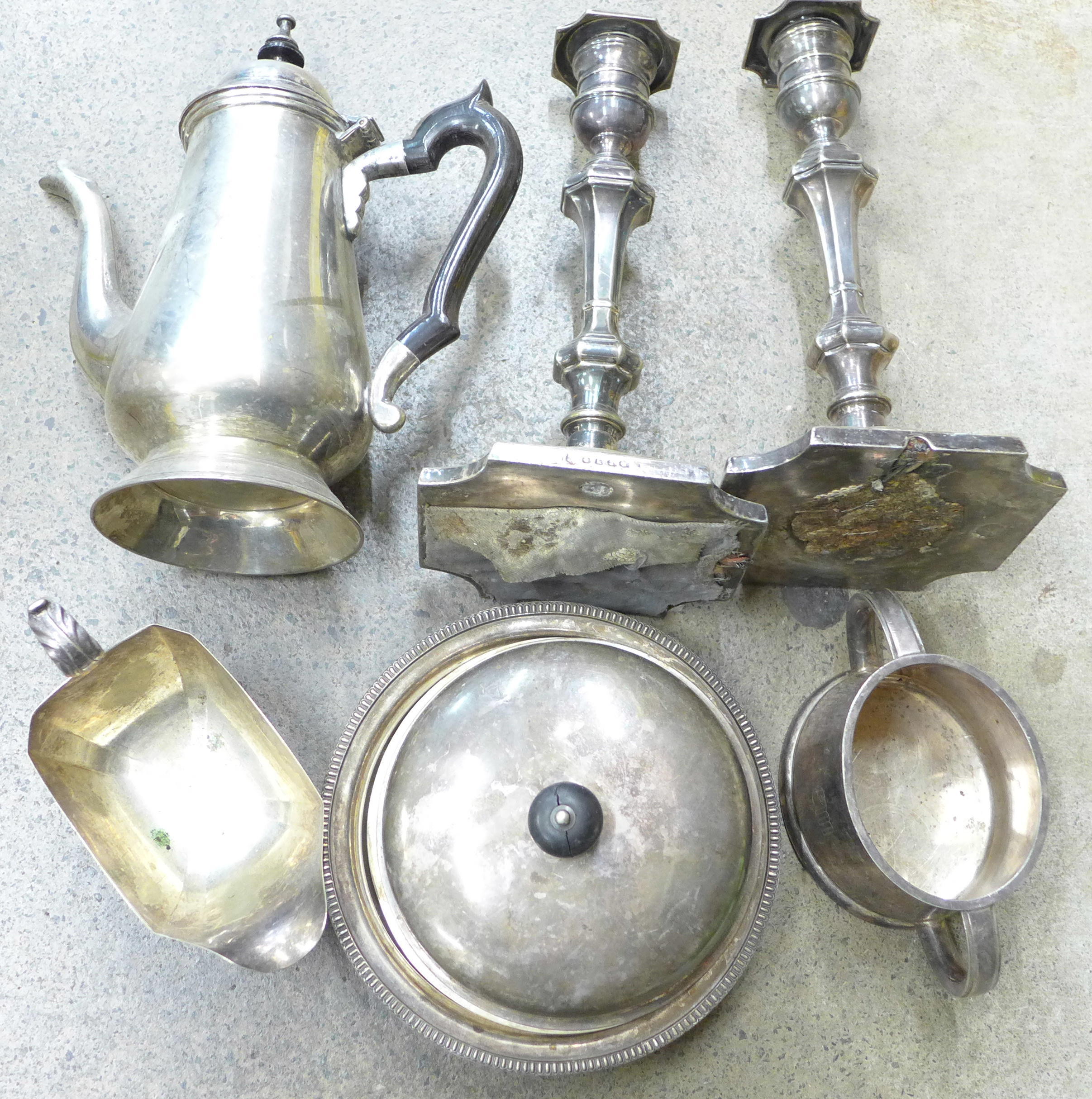 Lot 701 - A pair of plated candlesticks, muffin dish, coffee pot, etc.