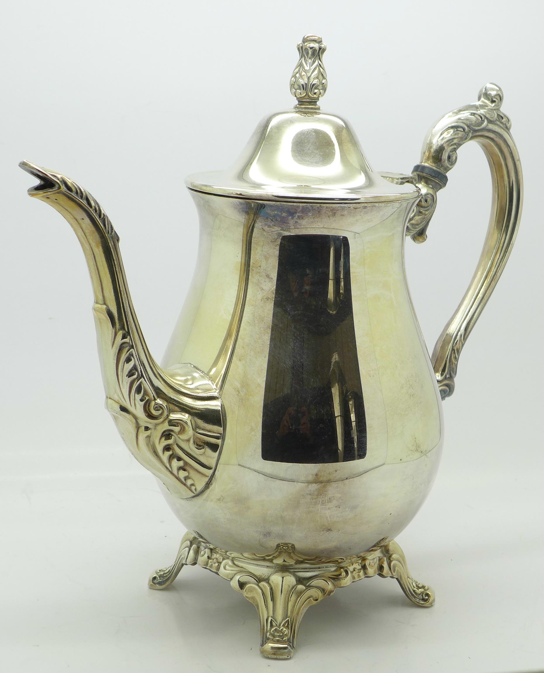 Lot 605 - A four piece plated tea service,