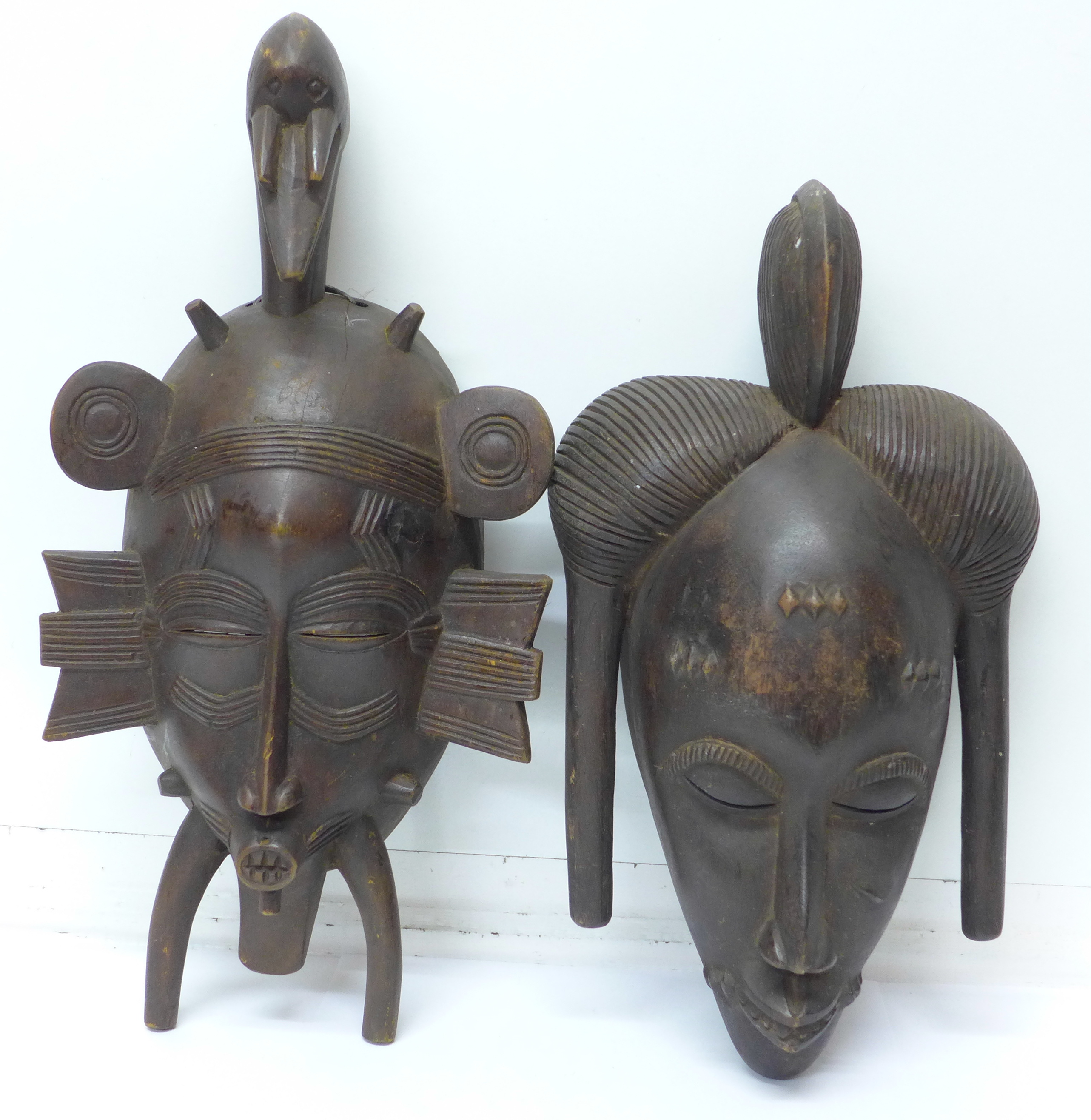 Lot 677A - Two carved African tribal masks