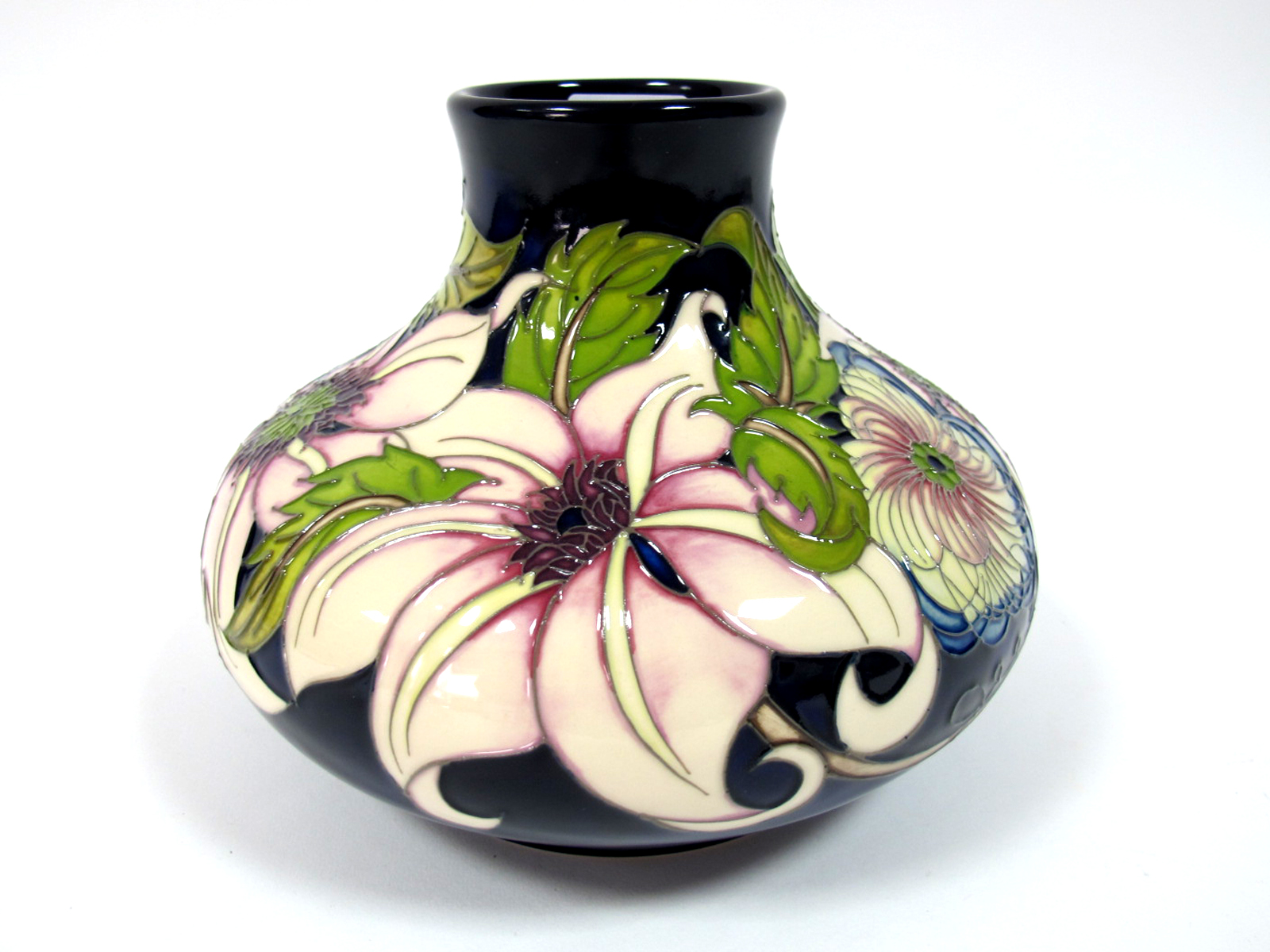 Lot 448 - A Modern Moorcroft Pottery Vase, of squat baluster form, painted in the Pure Innocence pattern
