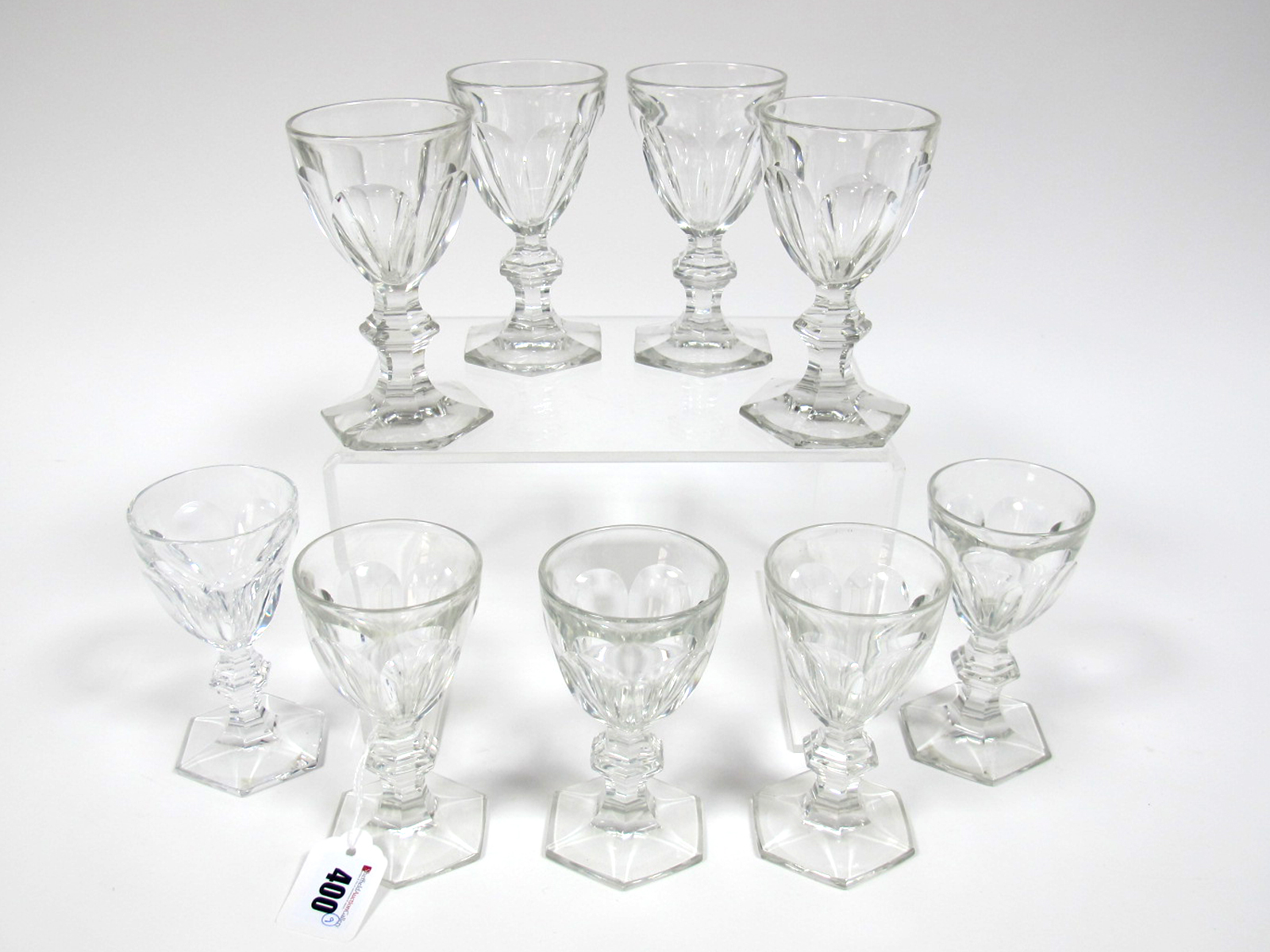 Lot 400 - A Set of Nine Baccarat 1930's Wine Glasses, in the Hamilton pattern, the slice cut acid bowls raised