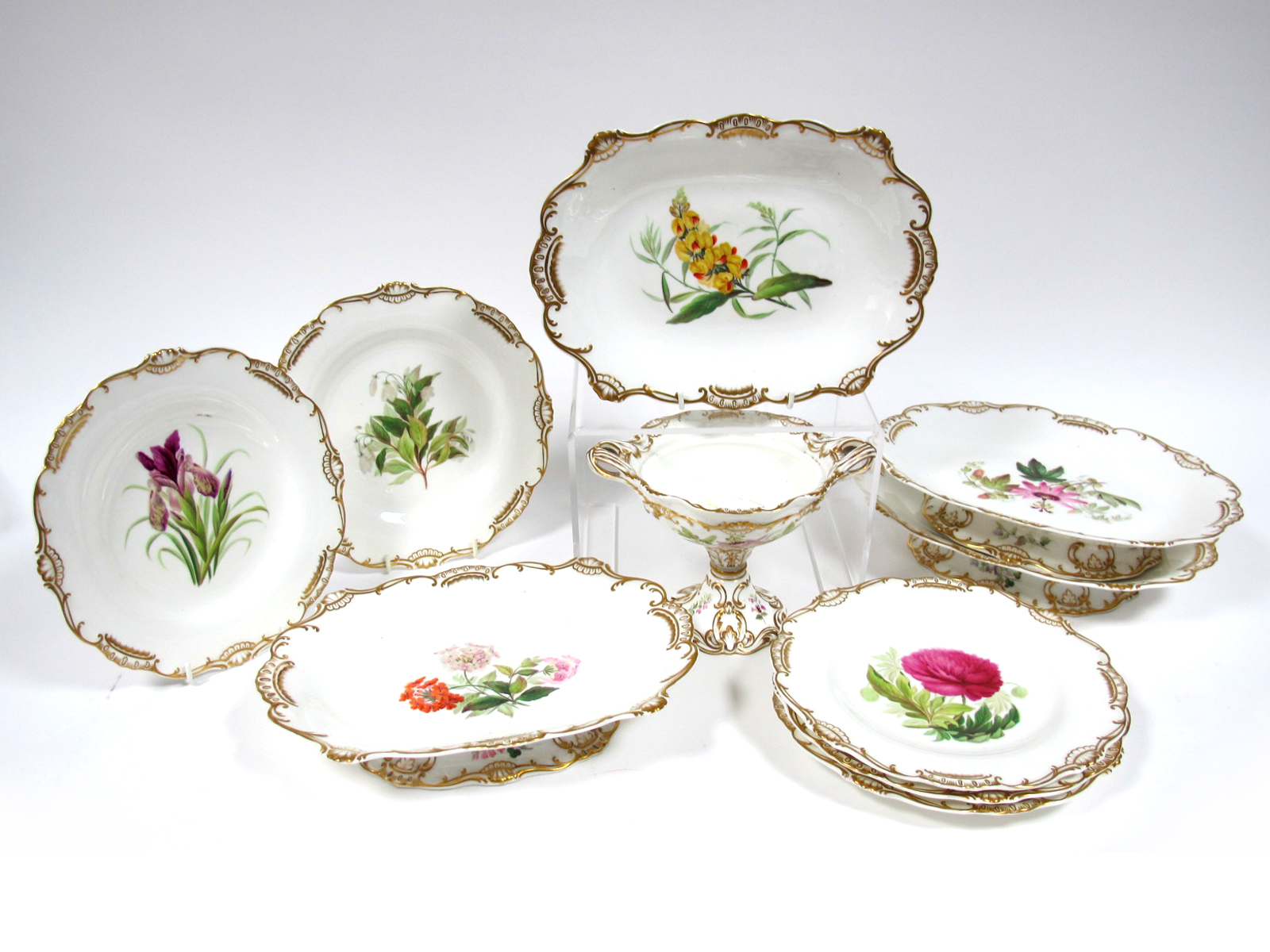 Lot 459 - A Mid XIX Century English Porcelain Part Dessert Service, each piece differently painted with a