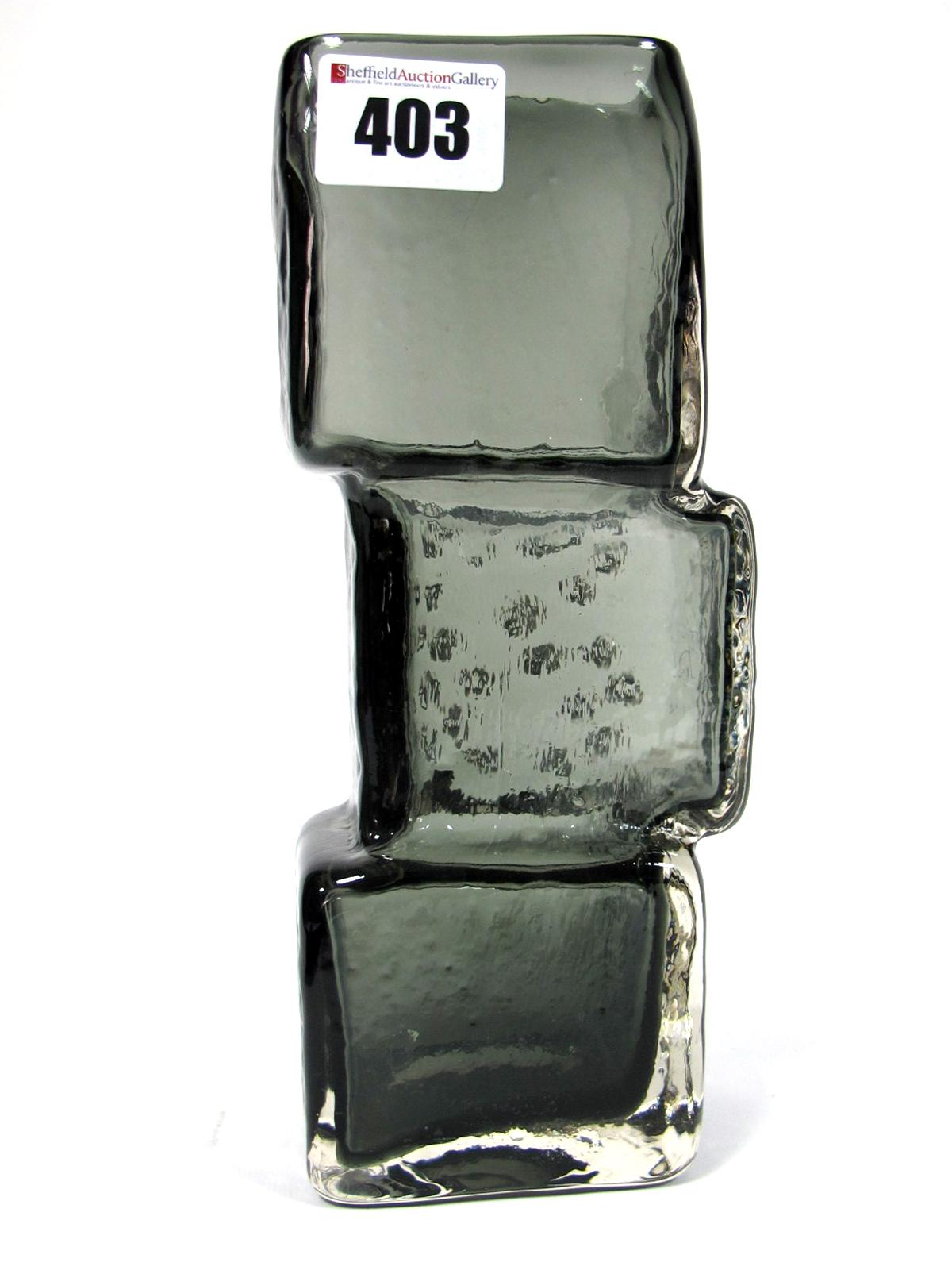 Lot 403 - A Whitefriars Glass Vase, designed by Geoffrey Baxter of 'Drunken Bricklayer' form, in indigo,