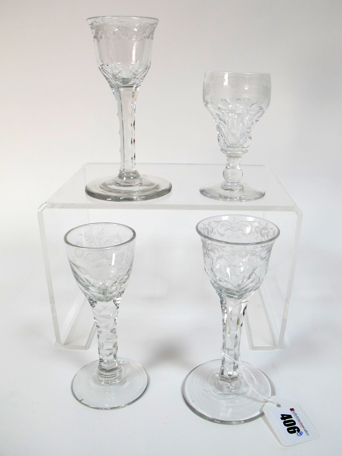 Lot 406 - A XIX Century Wine Glass, the ogee bowl etched with a bird and flowers, raised on faceted stem and