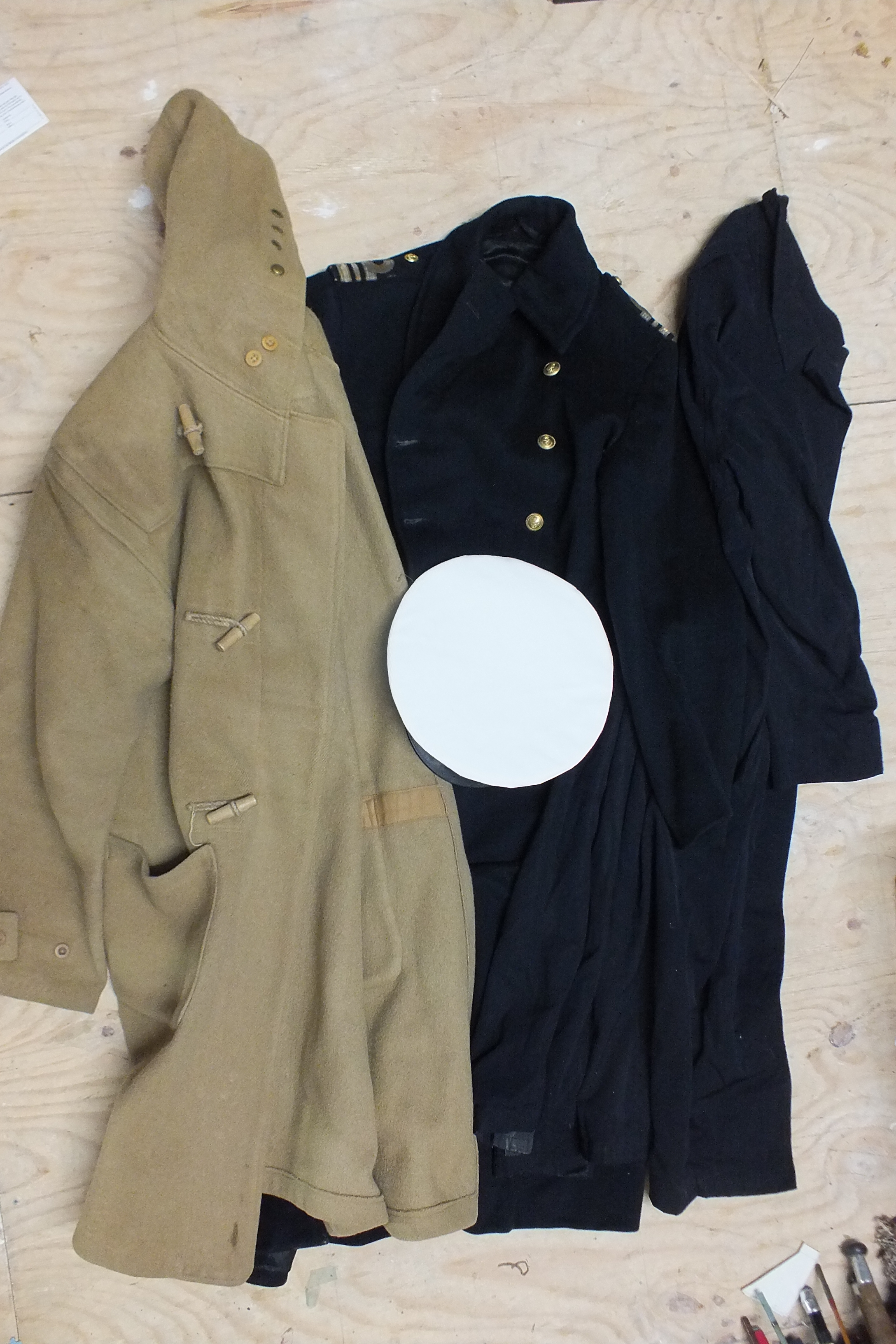 Lot 518 - A Royal Navy Gieves great coat, (Lt Commander) c1940's, a Royal Navy duffle coat, an Aquarock