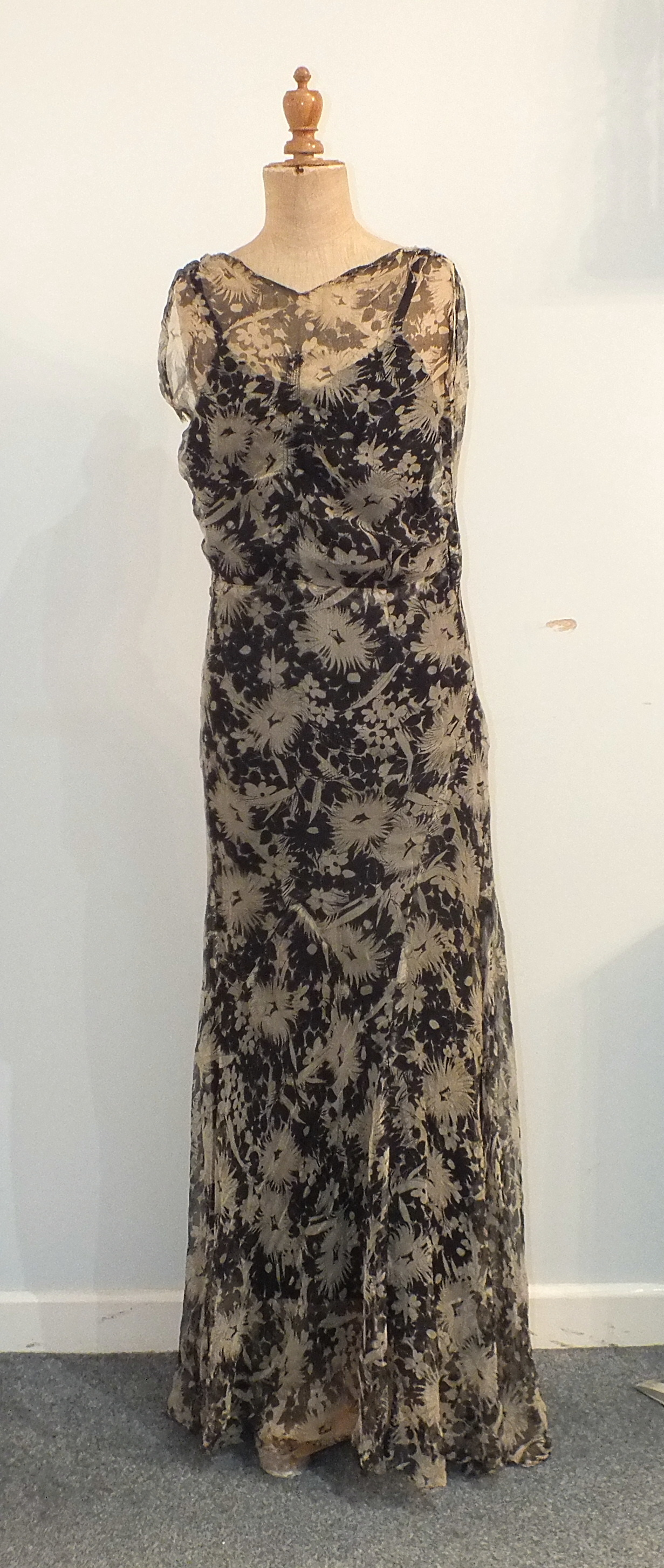 Five 1930's/1940's evening dresses including a black and white printed silk chiffon dress with black