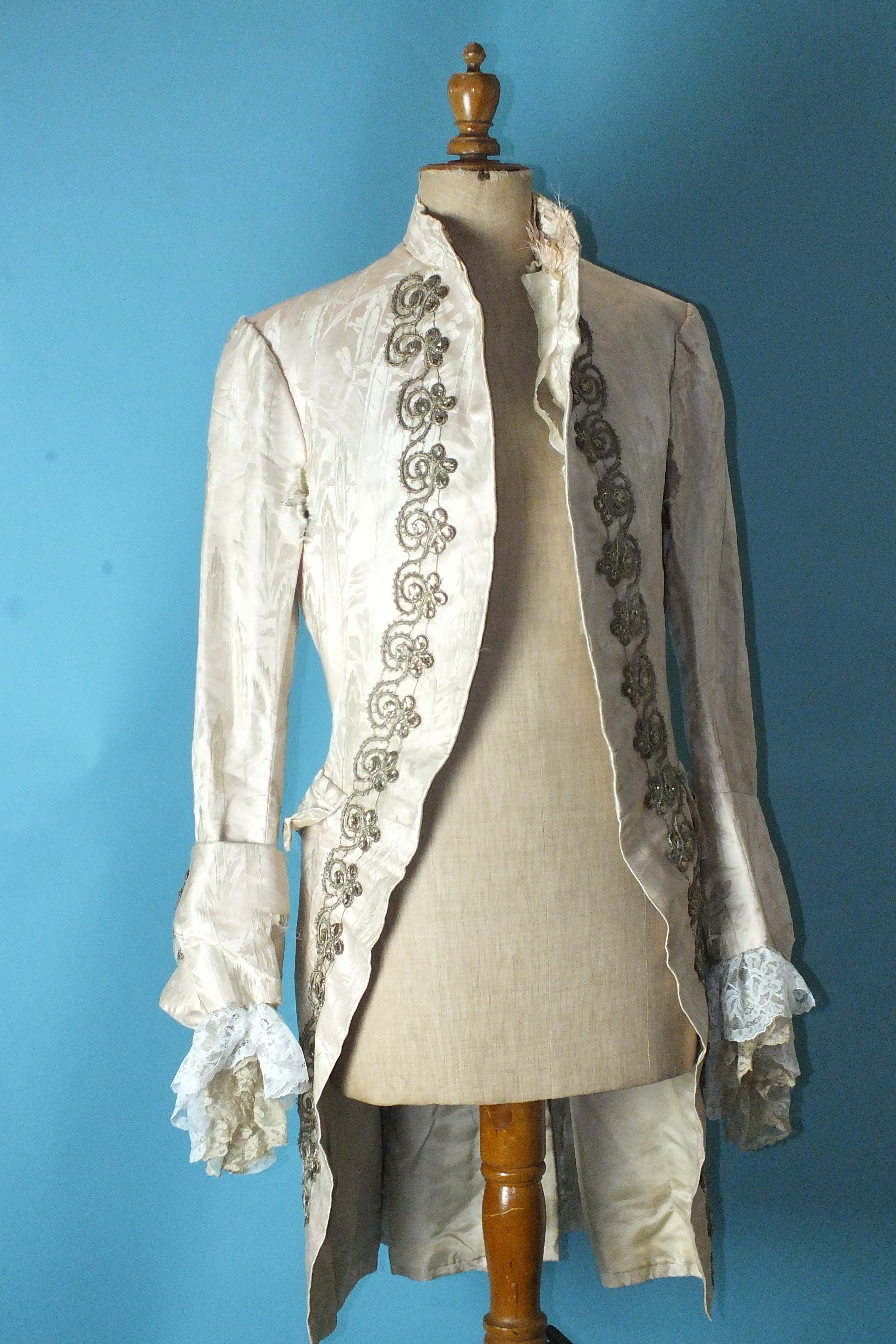 Lot 533 - A late-18th century gentleman's very pale pink silk brocade coat, the front and cuffs embellished