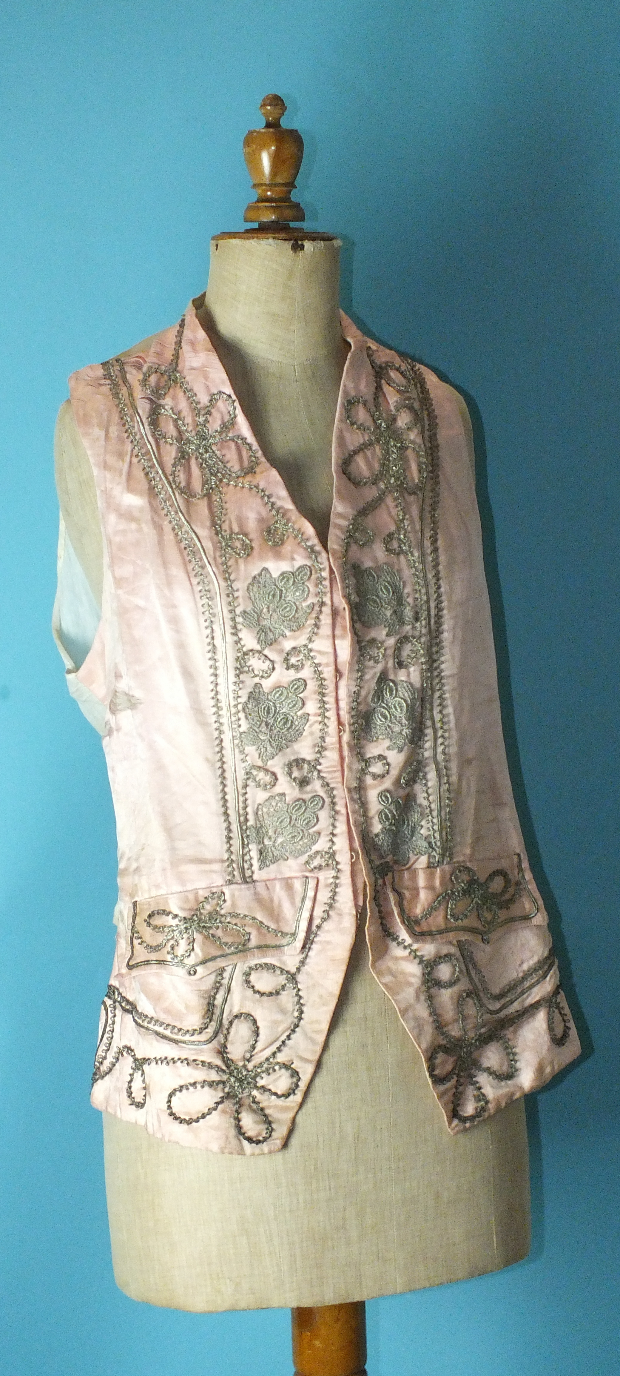 A late-18th century pale pink silk waistcoat, the front panels with applied silver lace and braid, - Image 5 of 5