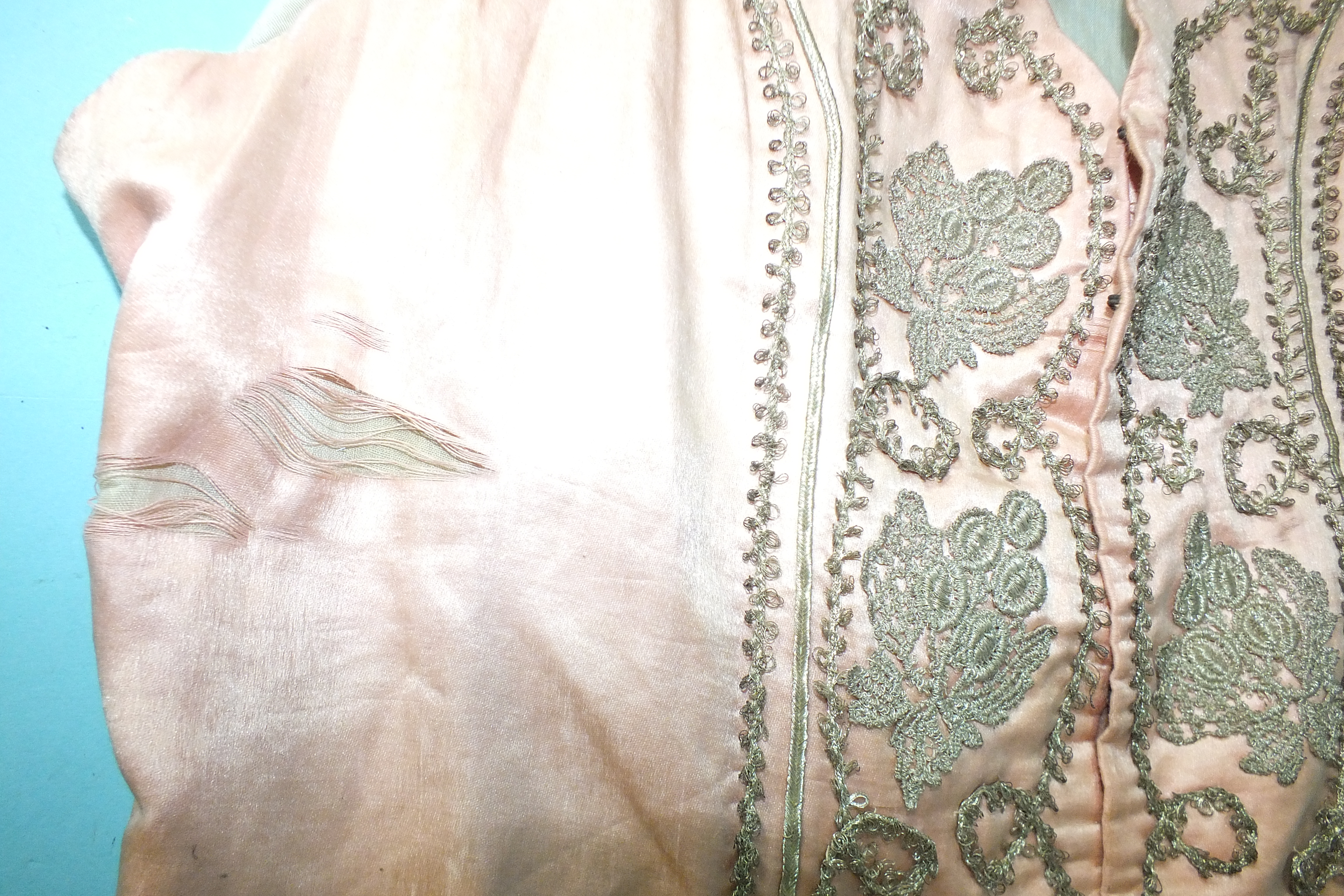 A late-18th century pale pink silk waistcoat, the front panels with applied silver lace and braid, - Image 2 of 5