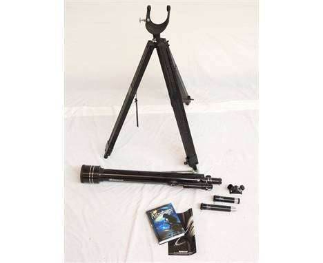 TASCO TELESCOPE with an adjustable tripod stand and interchangeable eye pieces; together with a Phillips Planisphere and a bo