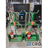Lot consists of (2) cutting torch carts with regulators, torch heads, hoses and fire extinguisher
