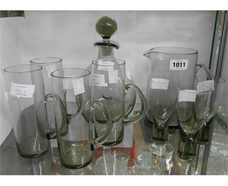 Nine pieces of 1960's Danish Holmegaard glassware comprising Per Lutken Danica smokey glass decanter and jug, three Canada co