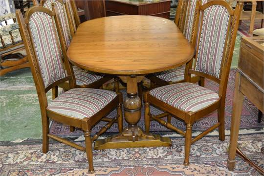 A Parker Knoll Dining Table And Six