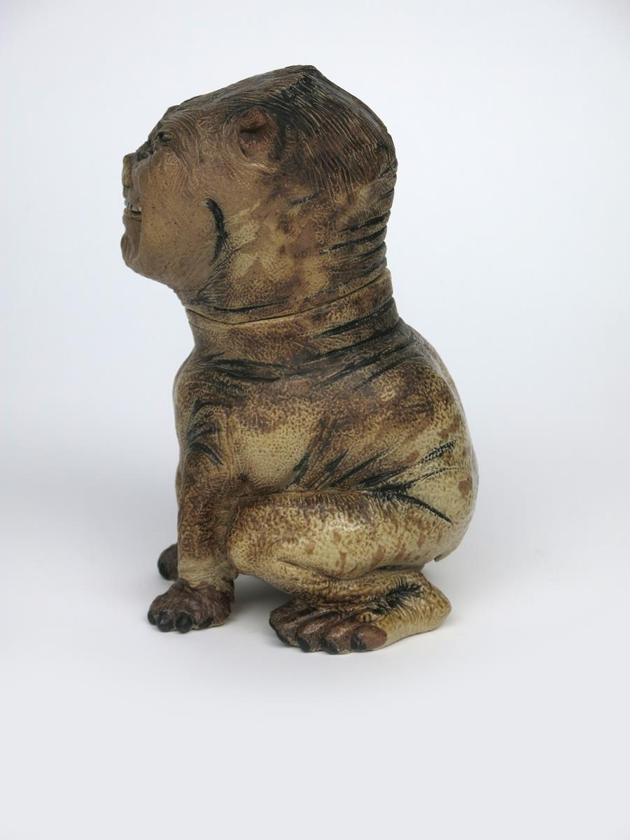 Lot 12 - A unique Martin Brothers stoneware grotesque dog jar and cover by Robert Wallace Martin, dated 1884,