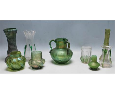 A collection of late Victorian 19th century and later Art Nouveau glassware comprising of Loetz style vases, a clear Art Nouv