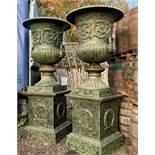 2.8M HIGH HUGE PAIR EXCEPTIONAL CAST IRON MONUMENTAL CAMPANA STYLE URNS ON PLINTH, IN THE MANNER OF