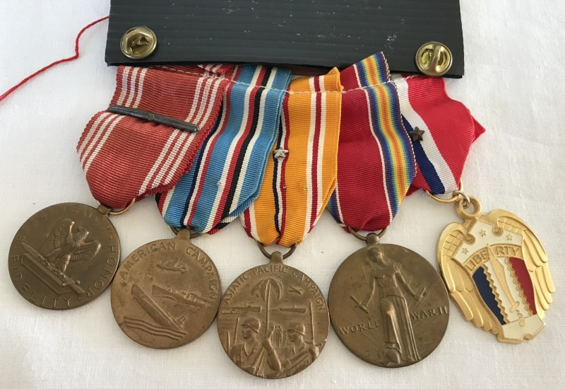 Lot 12 - WW2 United States medal group with copy of discharge certificate.