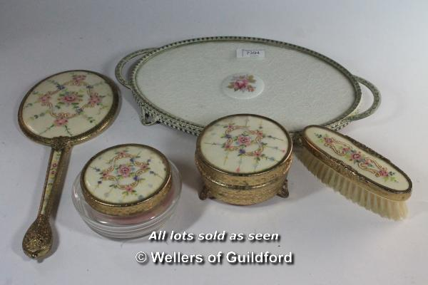 A 1950's dressing table set comprising oval tray, mirror, brush and two powder bowls.