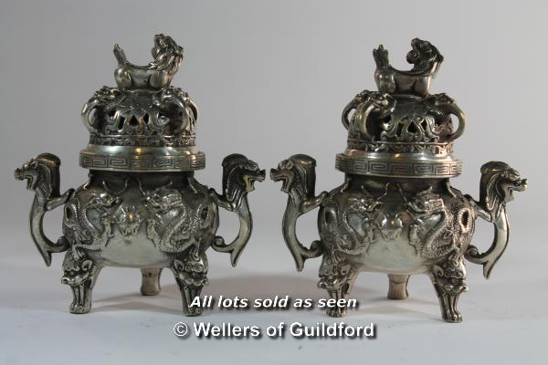 Lot 7196 - A matched pair of Chinese censors of circular form with dog of Fo finials, 13.5cm.