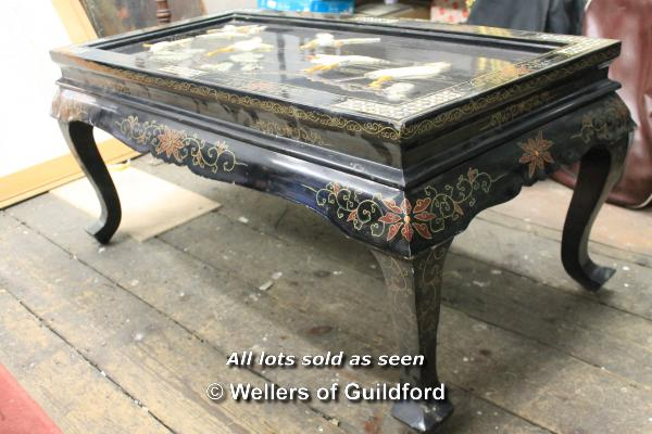Lot 7293 - *A Chinese lacquered low table with applied cranes, folding legs, 107 x 56cm.