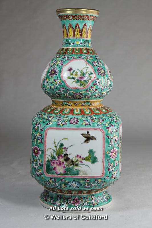 Lot 7243 - A large Chinese double vase with green ground, 30cm.