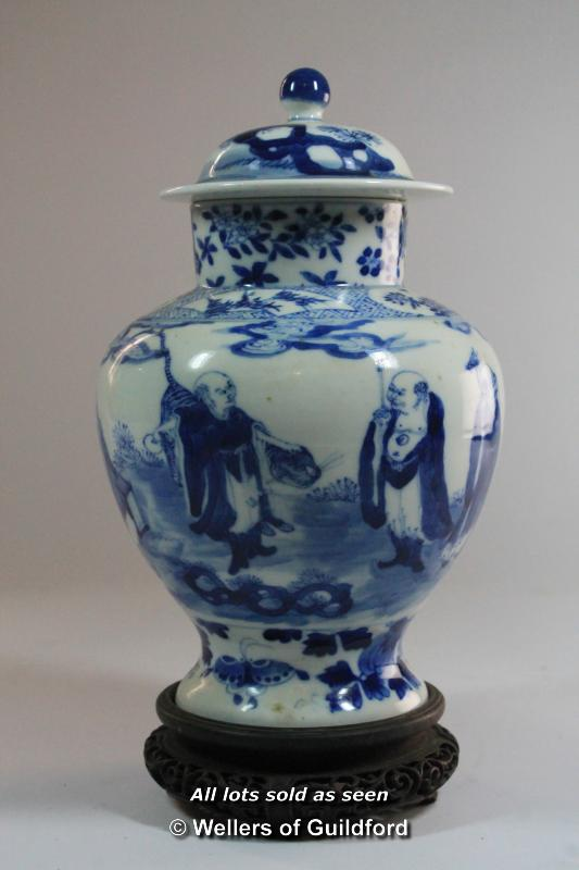 Lot 7385 - A Chinese blue and white ginger jar and cover, decorated with figures in a landscape, four character