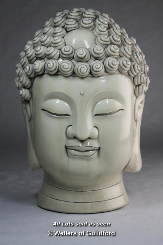 A Chinese blanc-de-chine portrait bust of Buddha, impressed mark to back of neck, 28cm.