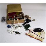 An embroidered box of costume jewellery;