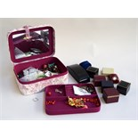 A fabric jewellery box containing some costume jewellery and other items and a platinin wedding