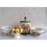 A ceramic bowl of fruit,