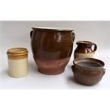 Three stoneware jars and a jug