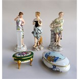 Three continental figurines of women,