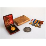 A set of four rosette medals: the 1914-915 star, The British War Medal,