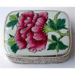 A poss Indian lidded trinket box with a floral decoration.