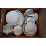 A plain white Italian porcelain part dinner service