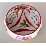 A Wemyss Ware one of a kind hand painted bowl, decorated with roses connected by swathes,
