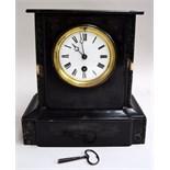 A slate mantel clock