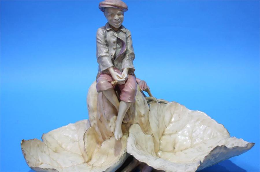 Lot 70 - A porcelain Amphora with a boy seated between two