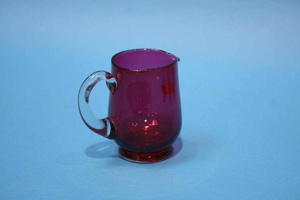 Lot 62 - Eight Cranberry beakers, a cream jug and sugar bowl (10)