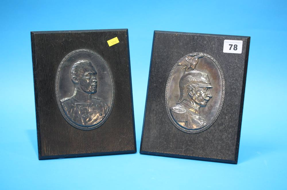 Lot 78 - A pair of German oval metalware relief plaques, depicting German military