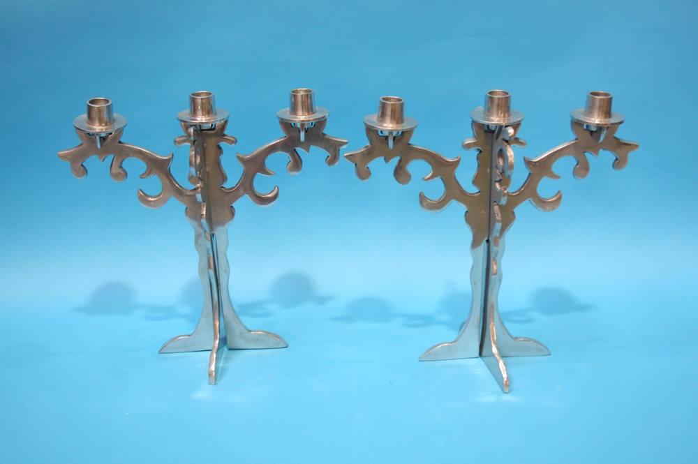 Lot 55 - A set of four Chrome candlesticks and a pair of aluminium 3 sconce candelabra