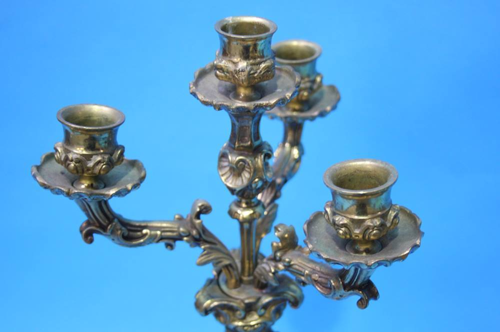 Lot 25 - A brass four sconce candelabra