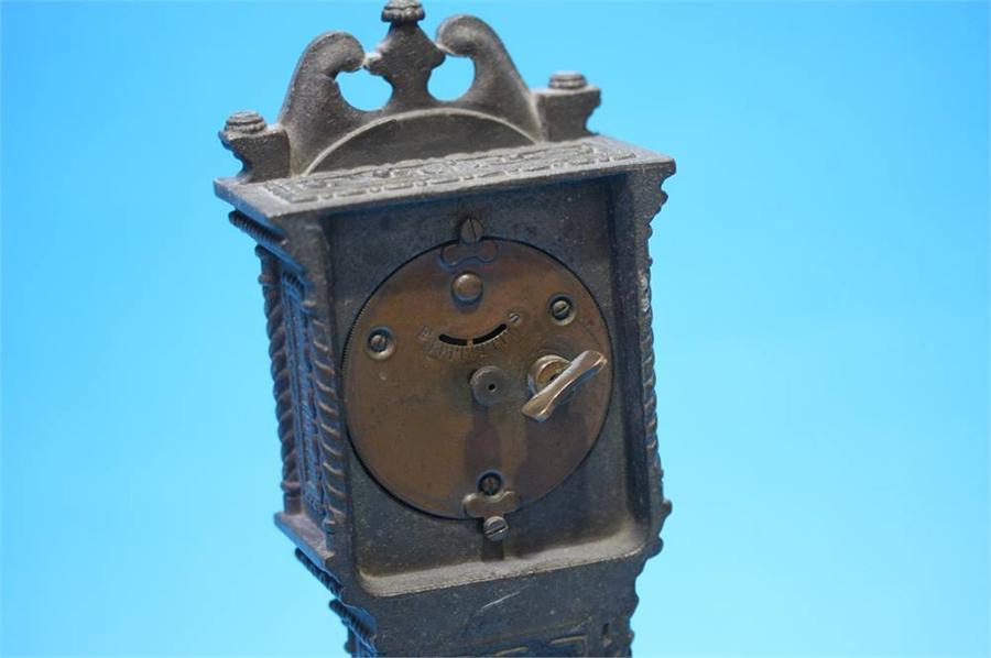 Lot 32 - A small metalware long case clock by Ansonin Clock