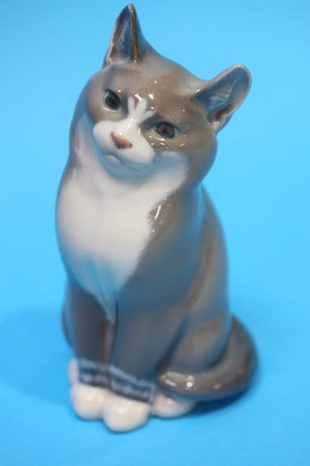 Lot 45 - A Royal Copenhagen cat, numbered 1803 and another