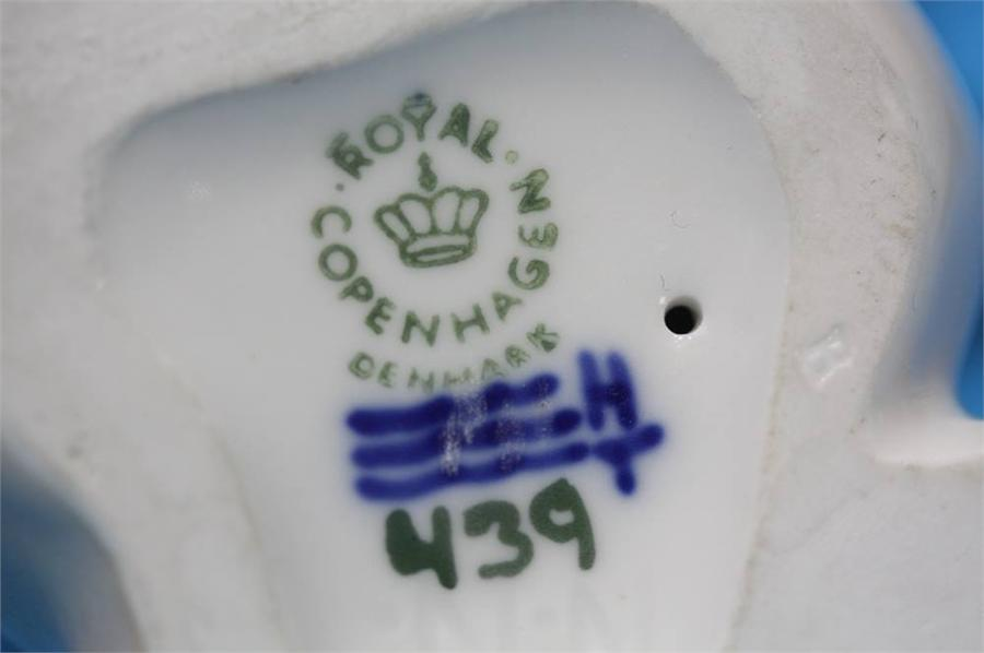 Lot 15 - A Royal Copenhagen Deer, number 2636, a seated dog